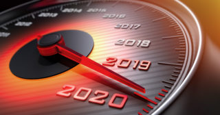 Speedometer marked with years, needle is approaching 2020