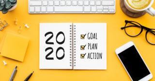 2020 list of new year new you goals on notepad on yellow background