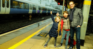 Babybreaks.com founder Guillame Thevenot with his two children on train platform