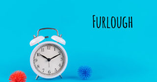 Image of a clock next to virus particles with the word furlough