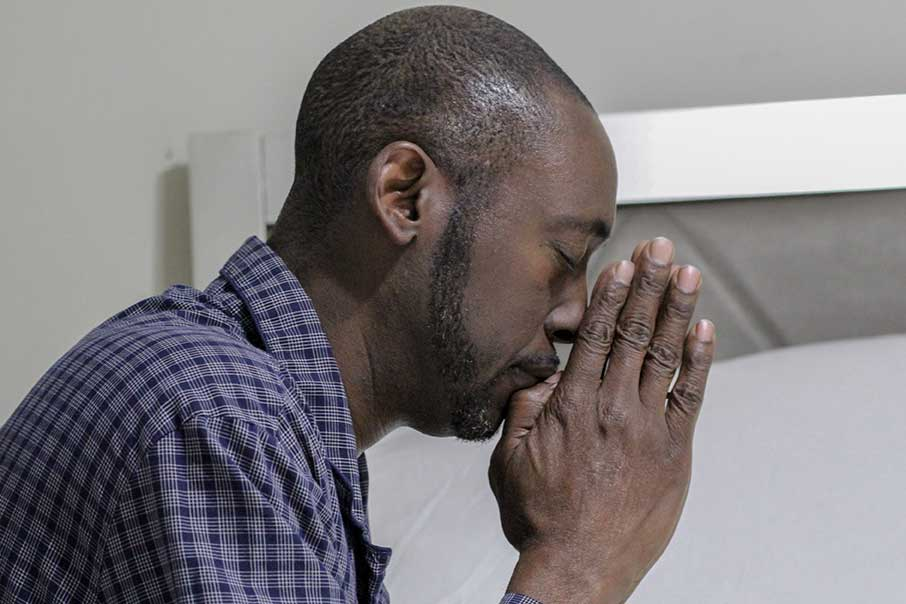 Man looking stressed and depressed with his head in his hands