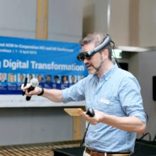 Man with VR headset and microphone at virtual event