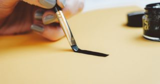 a line being drawn with ink