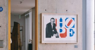 Barack Obama poster on bare wall featuring picture of Barack Obama and the word Hope