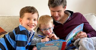 David Bird of Octopus Renewables reading a book with his two sons