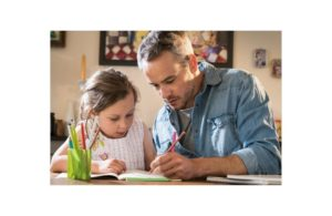 dad doing homework with child