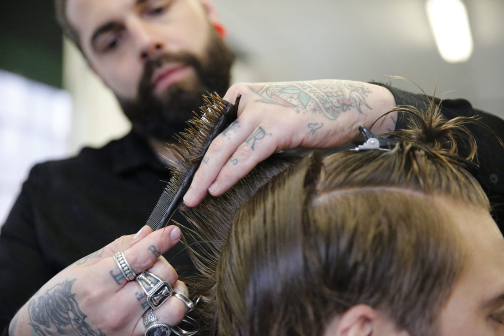 Tom Chapman of the Lions Barber Collective cutting hair