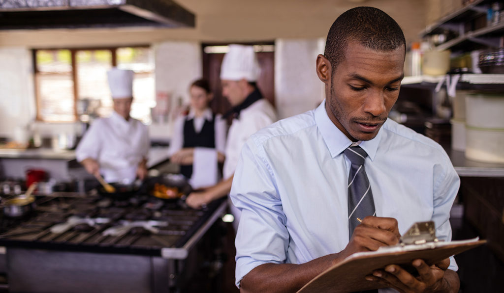 male manager in kitchen